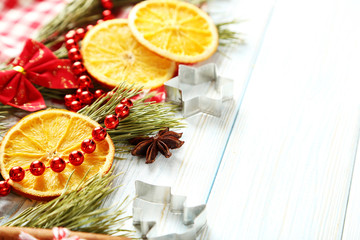 Christmas tree branch with dried oranges, cinnamon and anise sta