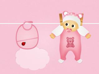 baby female and pink bib