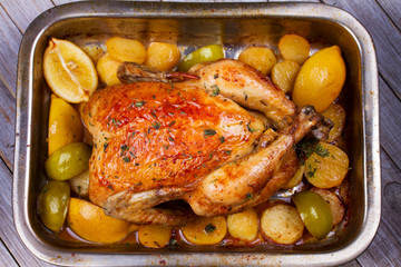 Chicken with Lemon, Lime, Potato and Thyme. View from above, top studio shot