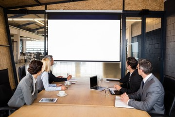 Business team using video chat during meeting