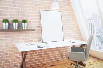 Creative desk with blank picture frame, mock up