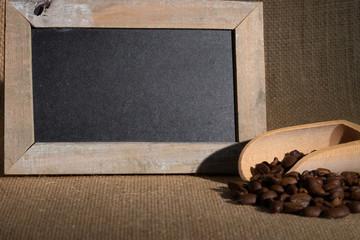 Coffee beans / Coffee beans blackboard lying on jute fabric
