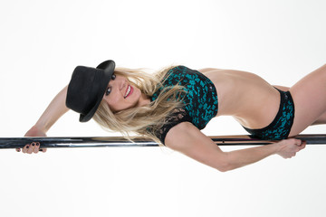 Flexible sexy girl dancing in black and green on the pole on white background copyspace, horizontal picture
