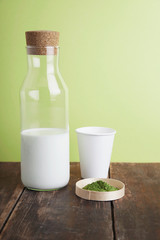 full milk bottle, matcha, paper glass on green back