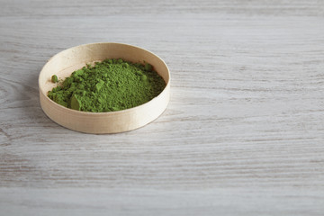Side view matcha tea in box on table
