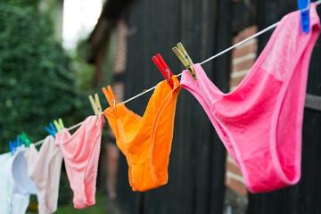Female panties hanging on rope