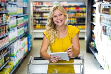 Blonde smiling woman checking list