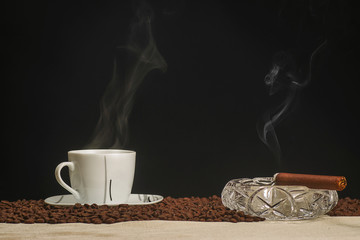 Hot coffee and lit a cigar