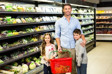Father and kids at the grocery store