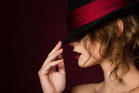 Portrait of young pretty woman with dark red lips wearing black