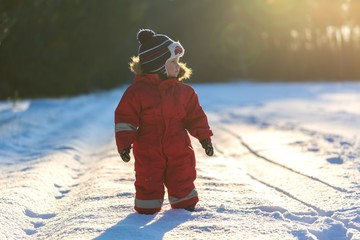 Boy playing in winter landscape. Child model