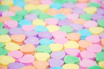 Selective focus of a candy heart background
