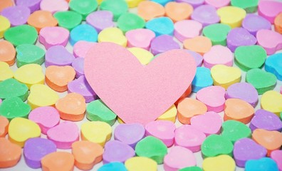 Candy hearts with a blank pink heart in the middle, can be used to add a message
