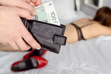 The man pays a prostitute with Polish money zloty