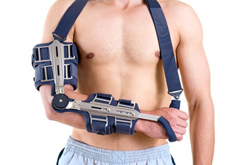 Shirtless Man with Arm in Articulated Sling.