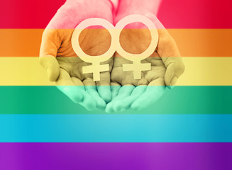 close up of lesbian couple hands with venus symbol