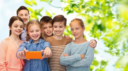 happy children talking selfie by smartphone