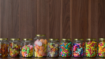 Various colorful sugary candy in a class jar