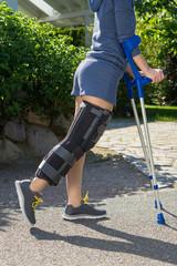 Young woman wearing a leg brace side view.