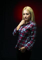 Young beautiful blonde in studio