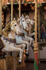 wooden horses on the carousel