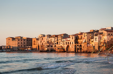 Panoramic view of the Cefalu coast at sunset. Sicily, Italy.