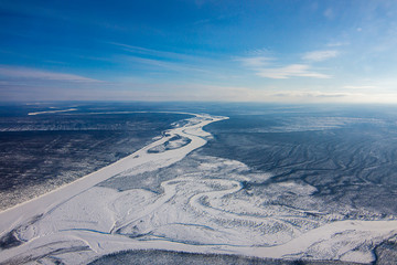 Aerial view from helicopter. Winter day scene.