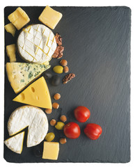Different varieties of cheese on a black board