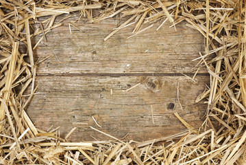 Straw frame on rustic wood