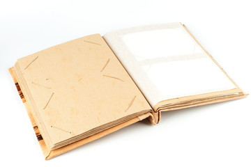 Open photo album with yellow cardboard