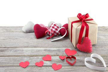 Assorted hearts and present on wood with white background