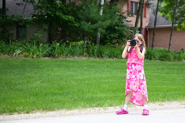 Girl in Colorful Dress with Camera and Copy Space