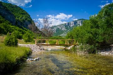 Landscape with wooden pedestrian bridge on the mountain river Komarnica in Nevidio aka Invisible Canyon, Montenegro