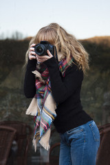 woman with photo camera outdoors