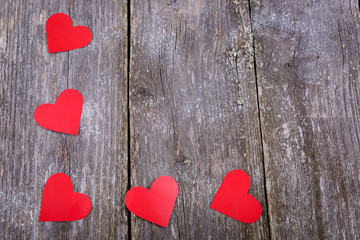 Valentines Day background with red hearts on old wooden backgrou