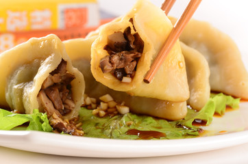 chinese dumplings with chicken and shiitake mushrooms with soy s