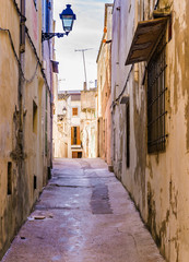 Wall Mural - View of a old nostalgic mediterranean narrow alleyway