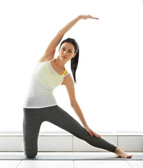 Yoga concept. Young attractive woman does exercises, close up