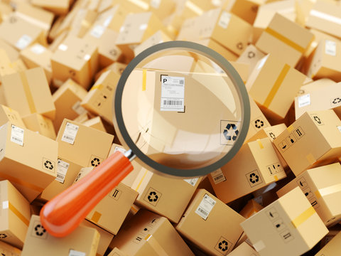 Distribution warehouse, international package shipping, global freight transportation, logistics, delivery and tracking concept, heap of cardboard boxes and magnifying glass zoom in parcel label
