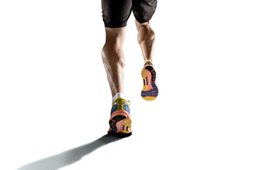 strong athletic legs with ripped calf muscle of young sport man running isolated on white background