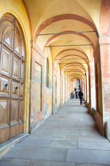 orange arcades that lead to the sanctuary of San Luca in bologna