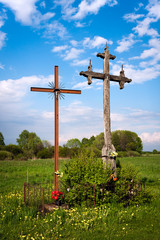 Roadside Christian crosses in a field