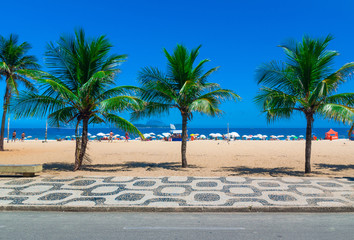 Ipanema beach with palms and mosaic of sidewalk in Rio de Janeiro. Brazil