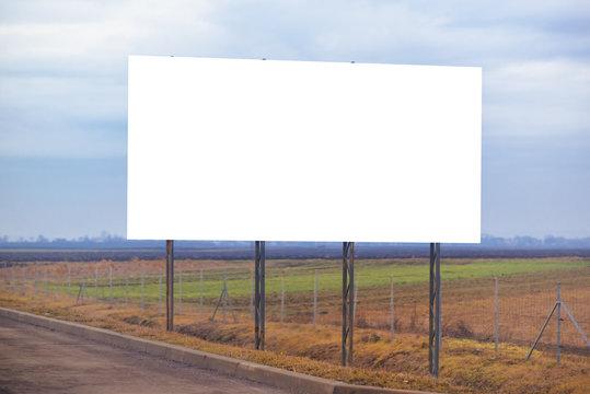 Blank billboard hoarding by the roadway