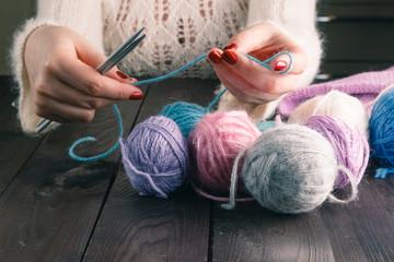 woman hands knitting with stylish knitting needles