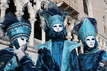 italy, venice. carnival masks posing in san marco square