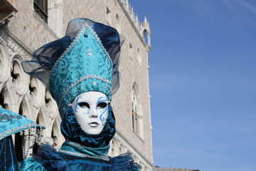 italy, venice. carnival mask posing in san marco square