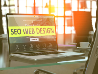 SEO - Search Engine Optimization - Web Design Concept. Closeup Landing Page on Laptop Screen  on background of Comfortable Working Place in Modern Office. Blurred, Toned Image. 3d Render.