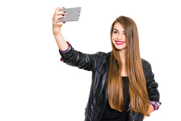 Modern teenage girl with long hair taking a selfie