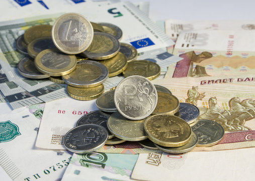 Russian roubles and Euro coins on banknotes
